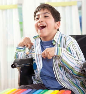 Picture of Boy in Wheel Chair Playing Xylophone