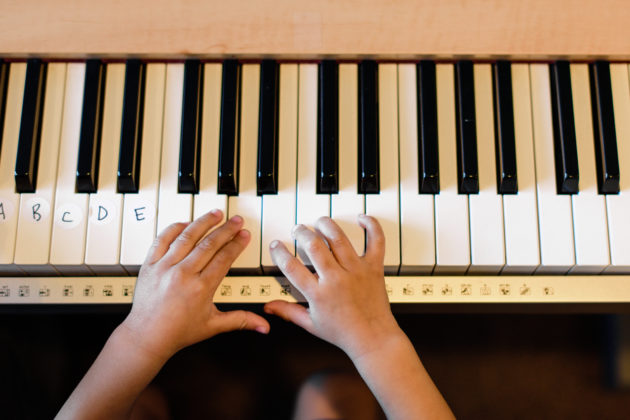 Picture of Young Child Playing Piano